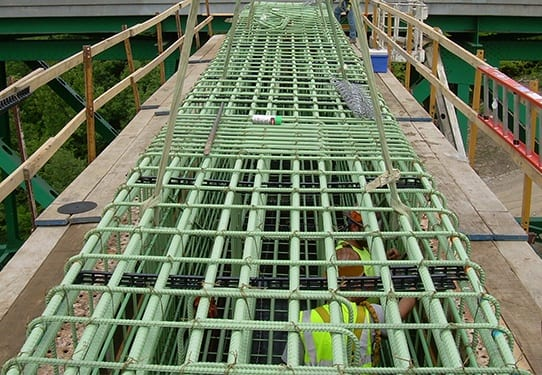 Whitacre Engineering team placing a rebar structure