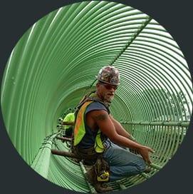 Whitacre Rebar team member installing green rebar structure